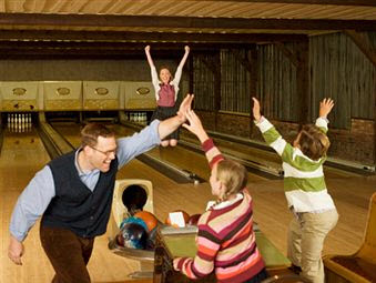 family enjoying their black friday bowling. fact.