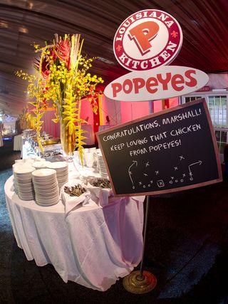 Faulk/Sanders invited Popeye's Chicken