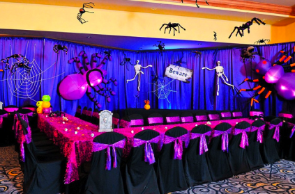 the kids area was piped and draped with over sized spider webs and 4 foot - Decorating For A Halloween Party