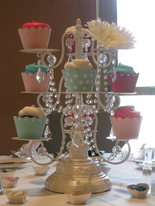 Cupcake holders as centerpieces for baking theme party